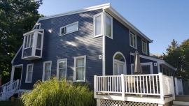 Belmont-MA-AFTER-Siding-Installation-James-Hardie-Fiber-Cement-Blue-Solid-State-Construction
